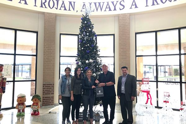 STRATA Gives to the Make A Wish Come True Program at University High School